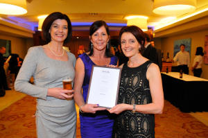 Cathy Price, centre, is presented with the certificate by Annabel Smith (left) and Ros Shiel (right) of Dea Latis.